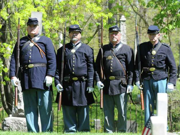 Civil War re-enactors from the 125th N.Y. Regiment of Troy, N.Y.,  stand at attention during a special dedication ceremony Civil War veteran Pvt. Thomas Ray, 21, of Albany, Friday morning, May 3, 2013, at St. Agnes Cemetery in Menands, N.Y.  Lincoln Elementary School students adopted the soldier from the 177th N.Y. volunteers infantry regiment 150 years after he died in Louisiana.  (Will Waldron/Times Union) Photo: Will Waldron