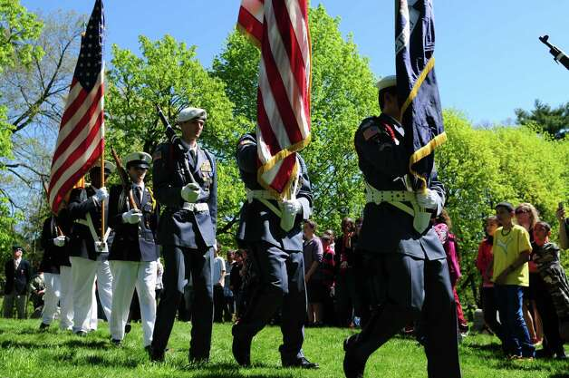 Color guard members from Christian Brothers Academy and LaSalle Institute march past sixth grader students from Lincoln Elementary School in Schenectady during a special dedication ceremony for Civil War veteran Pvt. Thomas Ray, 21, of Albany, Friday morning, May 3, 2013, at St. Agnes Cemetery in Menands, N.Y.  Lincoln Elementary School students adopted the soldier from the 177th N.Y. volunteers infantry regiment 150 years after he died in Louisiana.  (Will Waldron/Times Union) Photo: Will Waldron