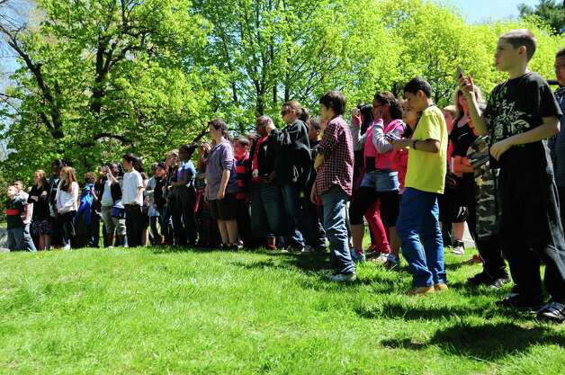 Sixth grader students from Lincoln Elementary School in Schenectady stand at attention during a special dedication ceremony for Civil War veteran Pvt. Thomas Ray, 21, of Albany, Friday morning, May 3, 2013, at St. Agnes Cemetery in Menands, N.Y.  Lincoln Elementary School students adopted the soldier from the 177th N.Y. volunteers infantry regiment 150 years after he died in Louisiana.  (Will Waldron/Times Union) Photo: Will Waldron