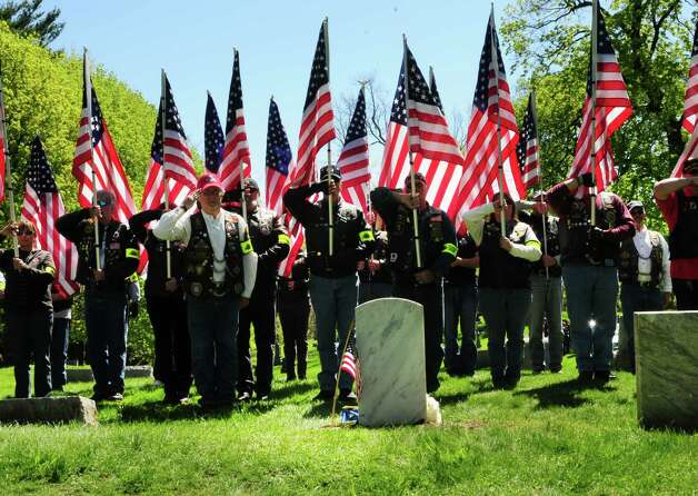 Patriot Guard Riders from regions 4 and 5 salute the grave of Civil War veteran Pvt. Thomas Ray, 21, of Albany, Friday morning, May 3, 2013, at St. Agnes Cemetery in Menands, N.Y.  Sixth graders from Lincoln Elementary School adopted the soldier from the 177th N.Y. volunteers infantry regiment 150 years after he died in Louisiana.  (Will Waldron/Times Union) Photo: Will Waldron