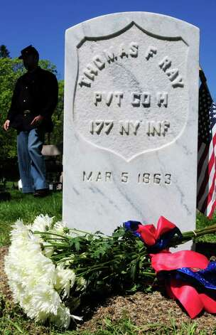 The grave of Civil War veteran Pvt. Thomas Ray, 21, of Albany, Friday morning, May 3, 2013, at St. Agnes Cemetery in Menands, N.Y.  Sixth graders from Lincoln Elementary School adopted the soldier from the 177th N.Y. volunteers infantry regiment 150 years after he died in Louisiana.  A special dedication ceremony was held Friday. (Will Waldron/Times Union) Photo: Will Waldron