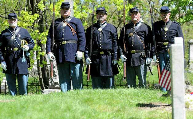 Civil War re-enactors from the 125th N.Y. Regiment of Troy, N.Y., march past the grave of Civil War veteran Pvt. Thomas Ray, 21, of Albany, Friday morning, May 3, 2013, at St. Agnes Cemetery in Menands, N.Y.  Sixth graders from Lincoln Elementary School adopted the soldier from the 177th N.Y. volunteers infantry regiment 150 years after he died in Louisiana.  A special dedication ceremony was held Friday. (Will Waldron/Times Union) Photo: Will Waldron