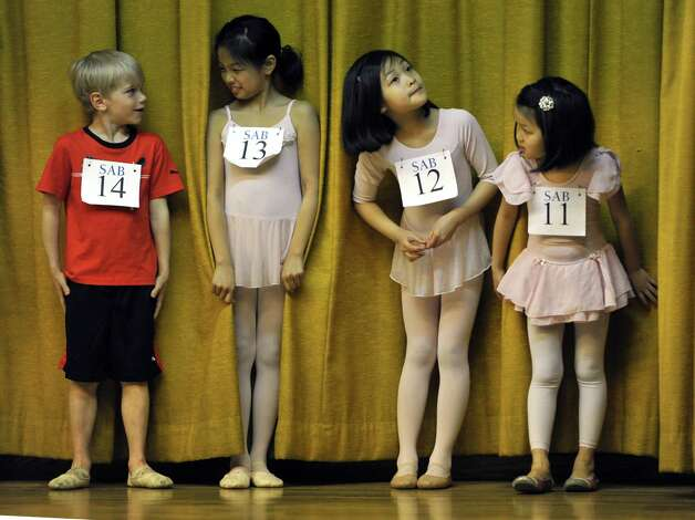 Young ballet dancers Daniel Chauvin, Renee Ng, Bridgette Ng and Natalie Ng  stand together as boys and girls ages 6 to 10 try out for The School of American Ballet during auditions at  P.S. 124 Yung Wing  May 3, 2013 in the city's Chinatown neighborhood, one in the school's ongoing series of audition events around the city.         AFP PHOTO / TIMOTHY A. CLARY Photo: TIMOTHY A. CLARY, AFP/Getty Images / AFP