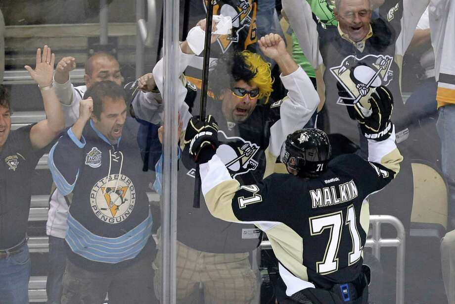 Pittsburgh Penguins' Evgeni Malkin (71) celebrates his goal in the first period of Game 2 of an NHL hockey Stanley Cup first-round playoff series against the New York Islanders, Friday, May 3, 2013, in Pittsburgh. (AP Photo/Gene J. Puskar) Photo: Gene J. Puskar, Associated Press / AP