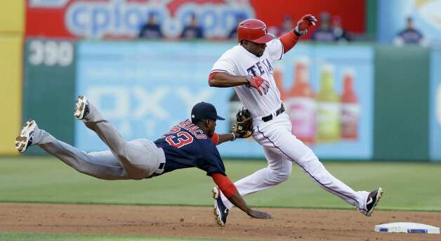 Texas Rangers' Elvis Andrus, right, is tagged out by Boston Red Sox shortstop Pedro Ciriaco (23) after he was caught off second base during the first inning of a baseball game Friday, May 3, 2013, in Arlington, Texas. (AP Photo/LM Otero) Photo: LM Otero, Associated Press / AP