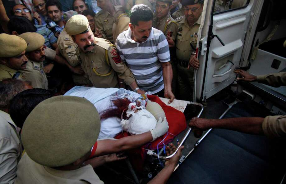 Pakistani prisoner Sanaullah Ranjay is carried on a stretcher to be shifted to another city for treatment, in Jammu, India, Friday, May 3, 20130. The prisoner in Indian-controlled Kashmir was beaten seriously Friday by another inmate, officials said, a day after a convicted Indian spy died after being bludgeoned with a brick by fellow inmates at a Pakistani prison. Ranjay was imprisoned in 1999 and was sentenced to life in prison in 2009 for being a Pakistani militant operating in Indian Kashmir. (AP Photo/Channi Anand) Photo: Channi Anand, Associated Press / AP