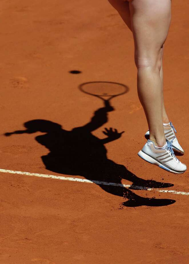 Russia's Anastasia Pavlyuchenkova casts a shadow while serving to Switzerland's Romina Oprandi during their Portugal Open semifinal tennis match Friday, May 3 2013, in Oeiras, outside Lisbon. Pavlyuchenkova defeated Oprandi 0-6, 6-3, 6-1. (AP Photo/Armando Franca) Photo: Armando Franca, Associated Press / AP