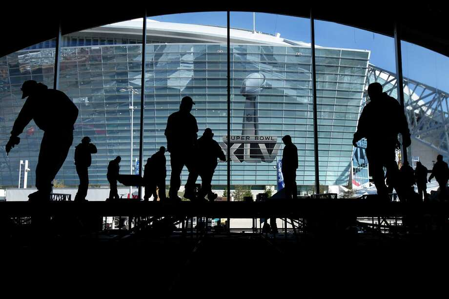 Workers disassemble the massive NFL tailgate party tent outside Cowboys Stadium in Arlington on Feb. 7, 2011, the day after Super Bowl XLV. Photo: Tom Fox, MBR / The Dallas Morning News