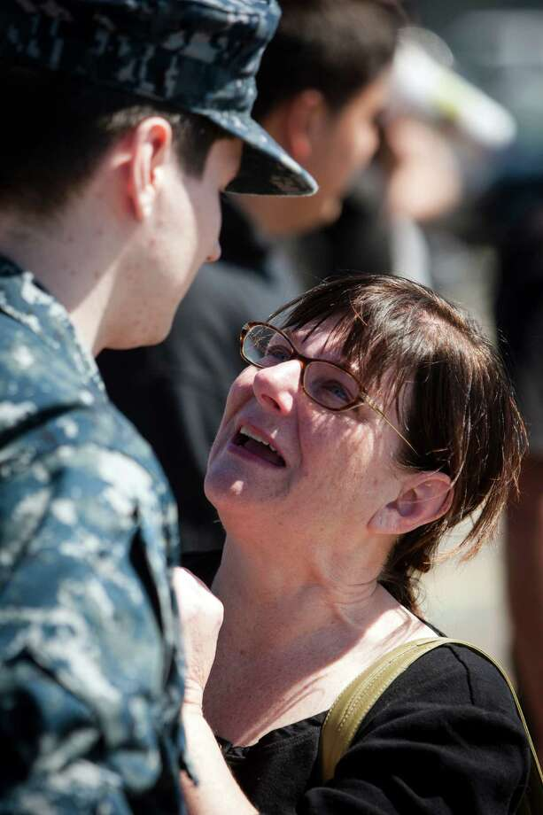 Roxie Chamuler, right, tears up while talking to her son, Scott Noseck, left, following an eight-month deployment Friday, May 3, 2013, in Bremerton. Noseck was released early, several weeks previously. Photo: JORDAN STEAD, SEATTLEPI.COM / SEATTLEPI.COM