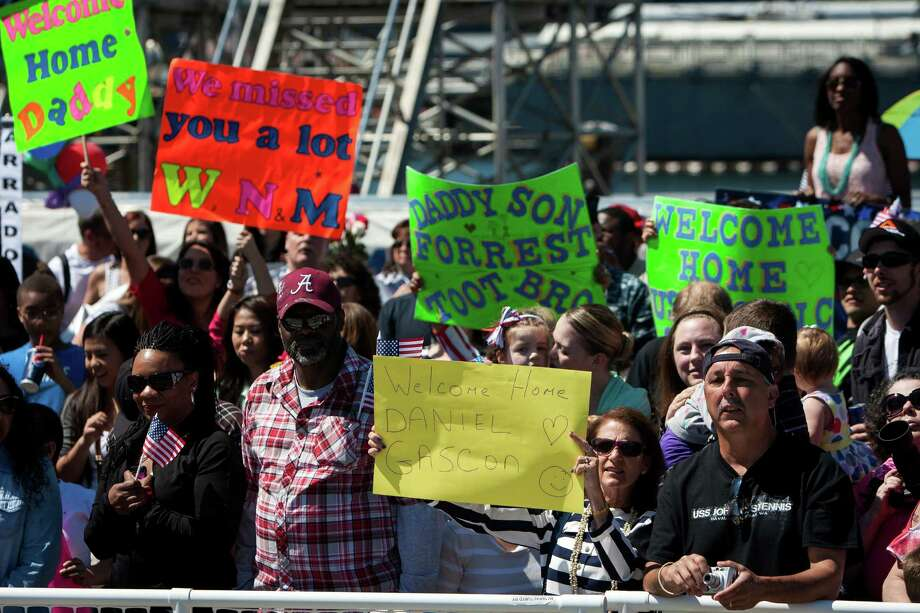 Crowds await the return of nearly 2,300 sailors aboard the USS John C. Stennis aircraft carrier following an eight-month deployment Friday, May 3, 2013, in Bremerton. The crew was stationed in the 5th and 7th fleet areas of U.S. responsibility, namely the Persian Gulf. Photo: JORDAN STEAD, SEATTLEPI.COM / SEATTLEPI.COM