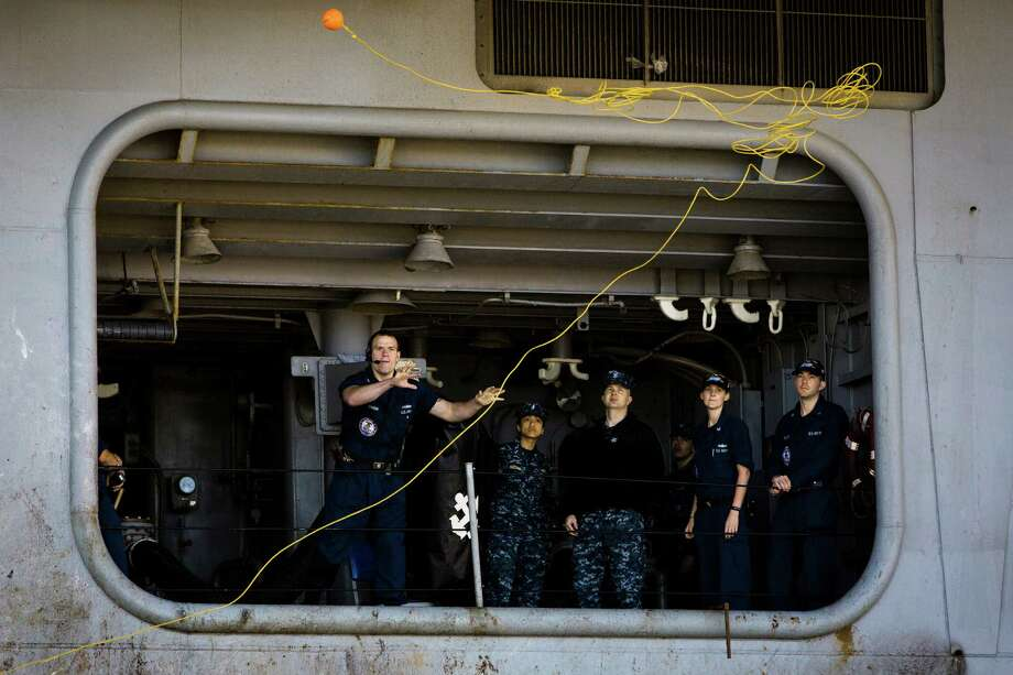 Sailors aboard the USS John C. Stennis aircraft carrier toss out the first rope following an eight-month deployment Friday, May 3, 2013, in Bremerton. The crew was stationed in the 5th and 7th fleet areas of U.S. responsibility, namely the Persian Gulf. Photo: JORDAN STEAD, SEATTLEPI.COM / SEATTLEPI.COM