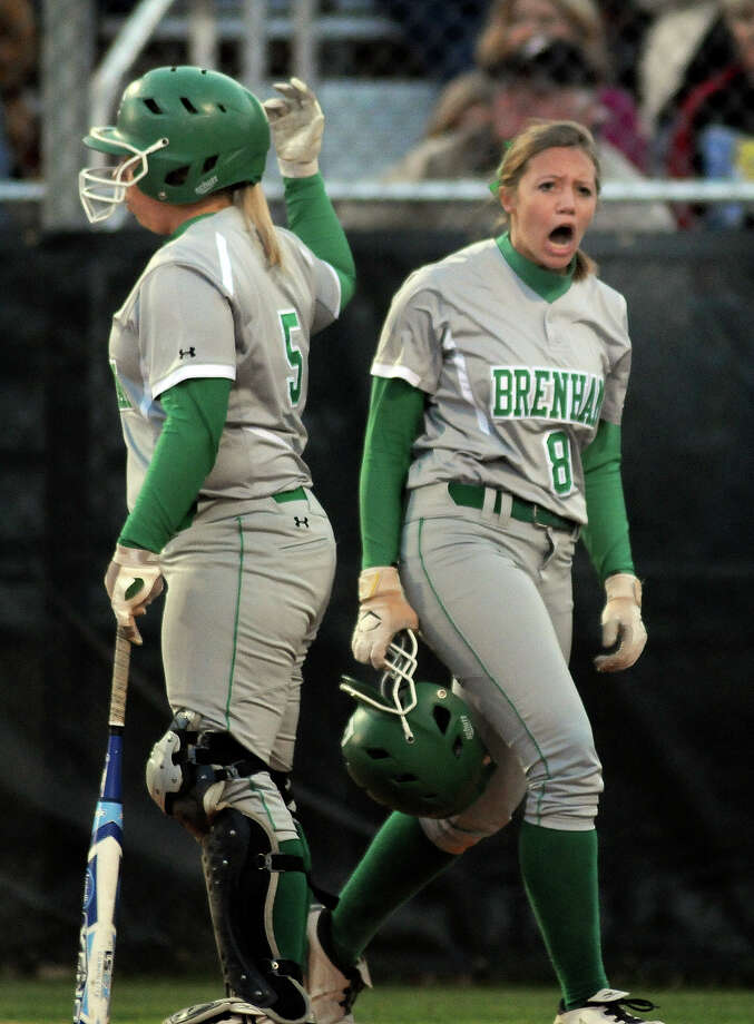 Brenham senior Olivia Van Hook, right, gets pimped up after scoring for the Cubettes in the top of the 5th inning of game two of their playoff series versus Barbers Hill at College Park High School on Friday. Photo: Jerry Baker, For The Chronicle