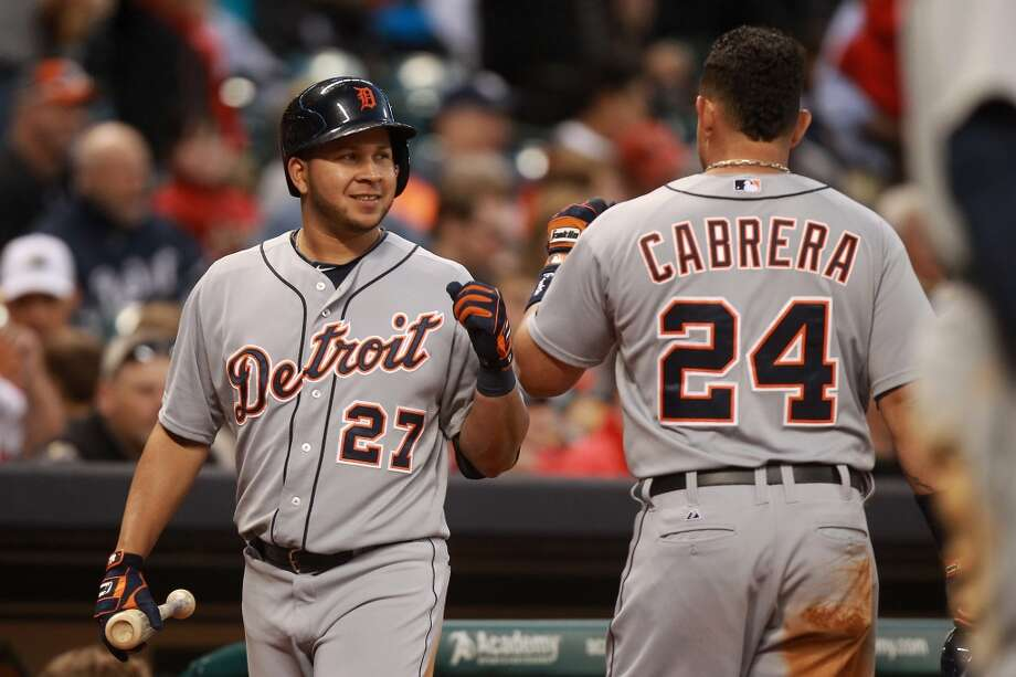 Miguel Cabrera and Jhonny Peralta of the Tigers celebrate after scoring runs.
