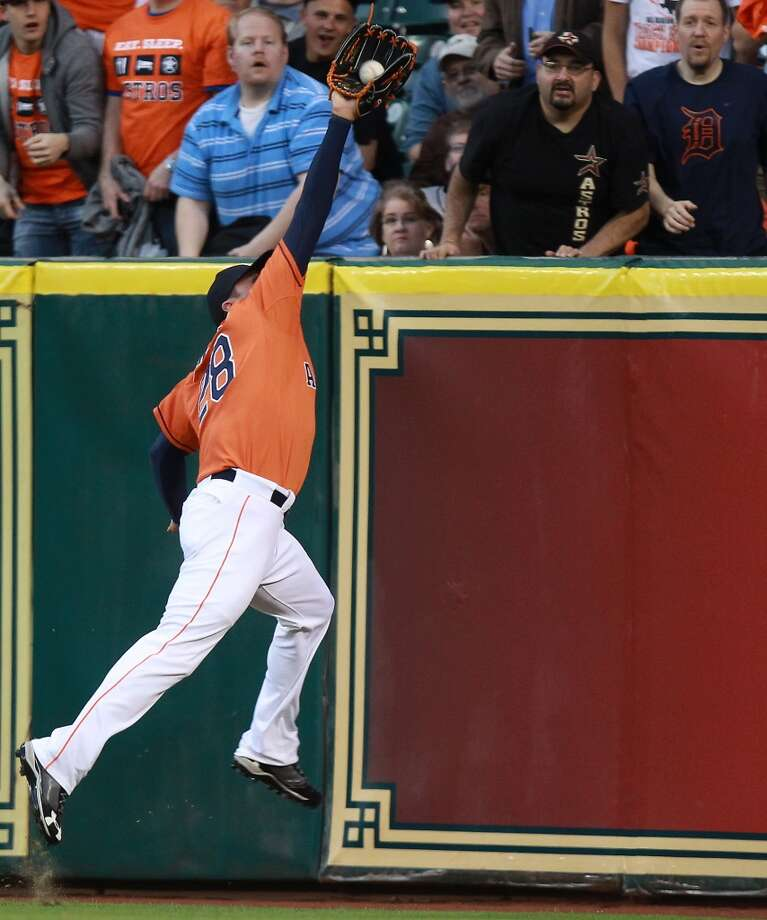 Rick Ankiel of the Astros makes a leaping catch for an out against the Tigers. Photo: Patric Schneider, Associated Press