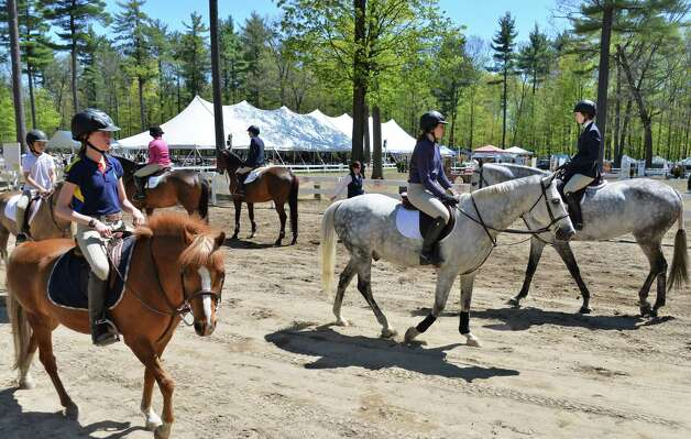 Competitors await their events during the 2013 Saratoga Springs Horse Show in Saratoga Springs, NY Friday May 3, 2013.  (John Carl D'Annibale / Times Union) Photo: John Carl D'Annibale / 10022249A