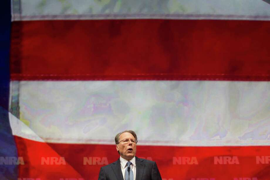 Wayne LaPierre, NRA executive vice president, speaks during the NRA-ILA Leadership Forum at the National Rifle Association's 142 Annual Meetings and Exhibits in the George R. Brown Convention Center Friday, May 3, 2013, in Houston. Photo: Johnny Hanson, Houston Chronicle / © 2013  Houston Chronicle