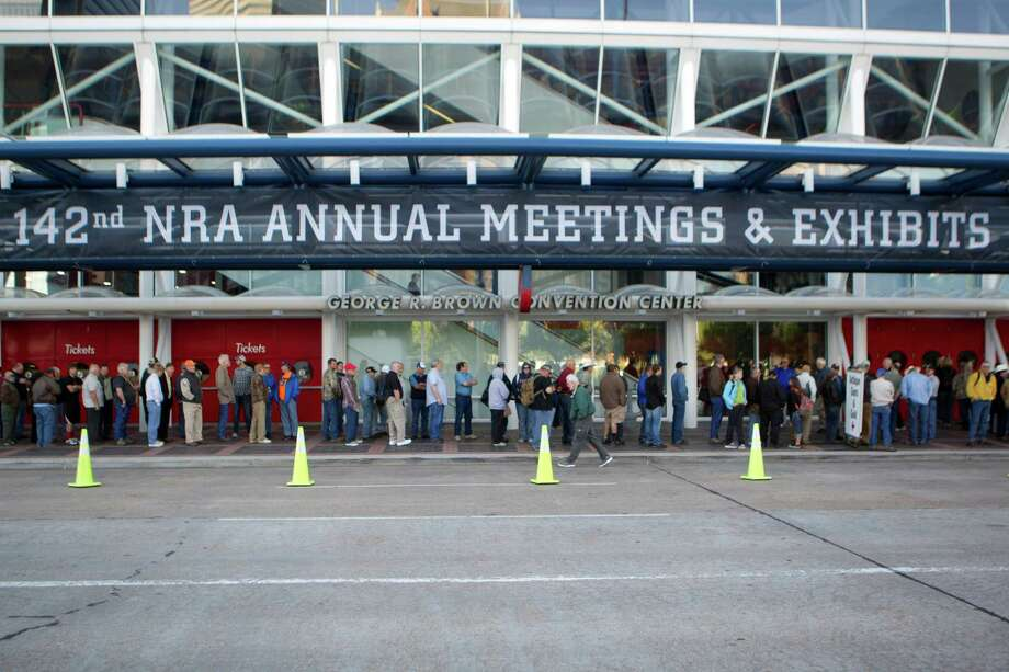 Attendees line up before the opening of the National Rifle Association's 142 Annual Meetings and Exhibits in the George R. Brown Convention Center Friday, May 3, 2013, in Houston. Photo: Johnny Hanson, Houston Chronicle / © 2013  Houston Chronicle