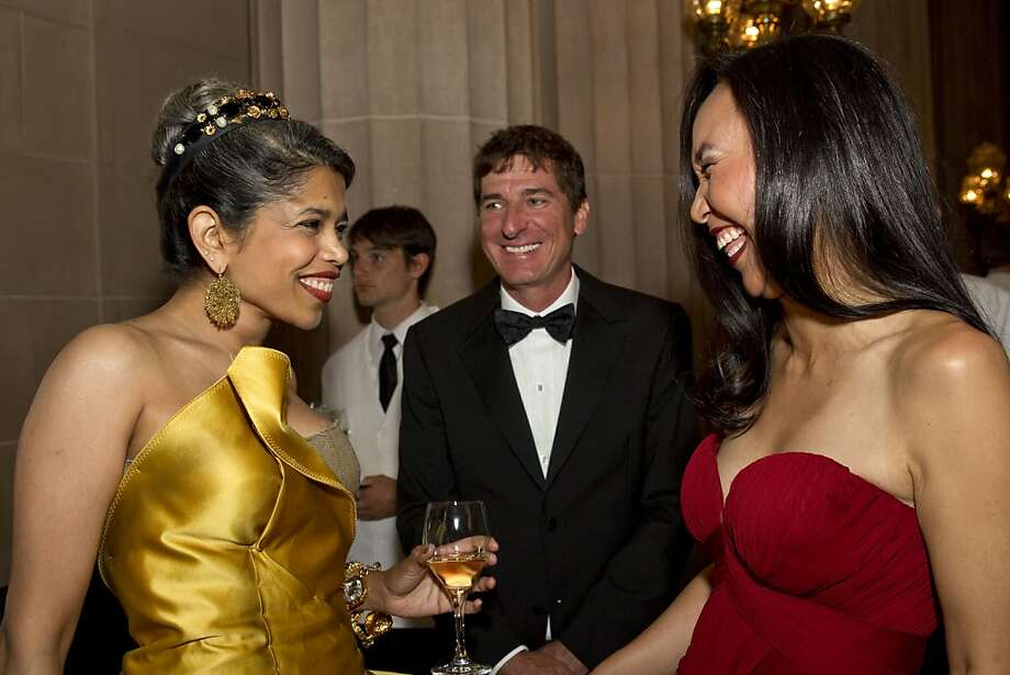 Deepa Pakianathan, Patrick King and Carolyn Chang (left to right) chat during the cocktail hour at the San Francisco Ballet's Cinderella Opening Night Ball at War Memorial Opera House in San Francisco, Calif., on Friday, May 3, 2013.  The party celebrated the opening night and United States premiere of choreographer Christopher Wheeldon's production of Cinderella. Photo: Laura Morton, Special To The Chronicle