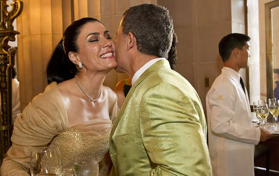 Afsaneh Akhtari (left) greets Jorge Maumer during the cocktail hour at San Francisco Ballet's Cinderella Opening Night Ball at War Memorial Opera House in San Francisco, Calif., on Friday, May 3, 2013.  The party celebrated the opening night and United States premiere of choreographer Christopher Wheeldon's production of Cinderella. Photo: Laura Morton, Special To The Chronicle