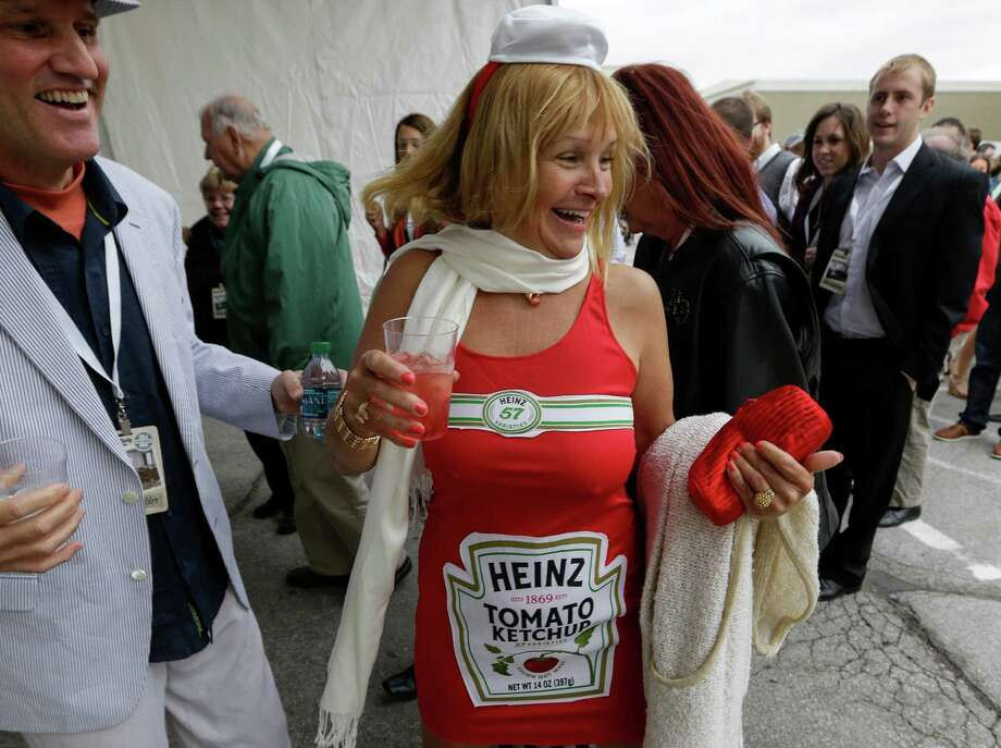 Karma Perrot of New Mexico arrives at a Friday reception for Berkshire Hathaway shareholders dressed as a Heinz Ketchup bottle. Berkshire recently purchased the H.J. Heinz Co. Photo: Nati Harnik, STF / AP