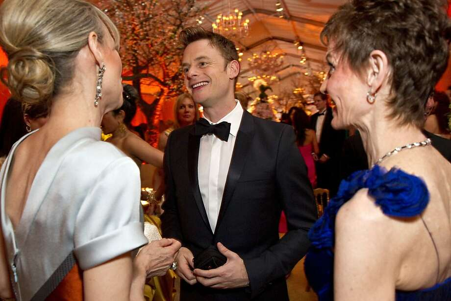Choreographer Christopher Wheeldon (center) talks with Christine Suppes (left) and Denise Littlefield Sobel at San Francisco Ballet's Cinderella Opening Night Ball at War Memorial Opera House in San Francisco, Calif., on Friday, May 3, 2013.  The party celebrated the opening night and United States premiere of Wheeldon's production of Cinderella. Photo: Laura Morton, Special To The Chronicle