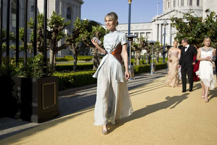 Christine Suppes walks to dinner wearing a Rodarte gown while attending San Francisco Ballet's Cinderella Opening Night Ball at War Memorial Opera House in San Francisco, Calif., on Friday, May 3, 2013.  The party celebrated the opening night and United States premiere of choreographer Christopher Wheeldon's production of Cinderella. Photo: Laura Morton, Special To The Chronicle