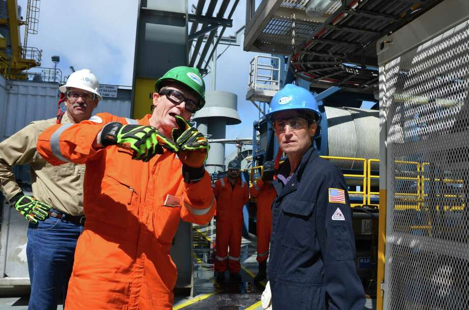 Ensco senior vice president John Knowlton talks with Interior Secretary Sally Jewell on Friday aboard the Ensco 8502 in the Gulf of Mexico. Photo: Jennifer A. Dlouhy