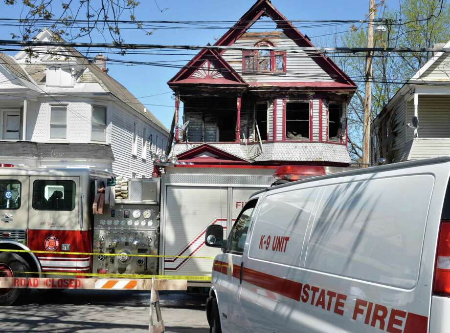 Fire investigators at 438 Hullett St. in Schenectady, NY Friday May 3, 2013.  A Thursday morning fire there left four people dead, including three children.