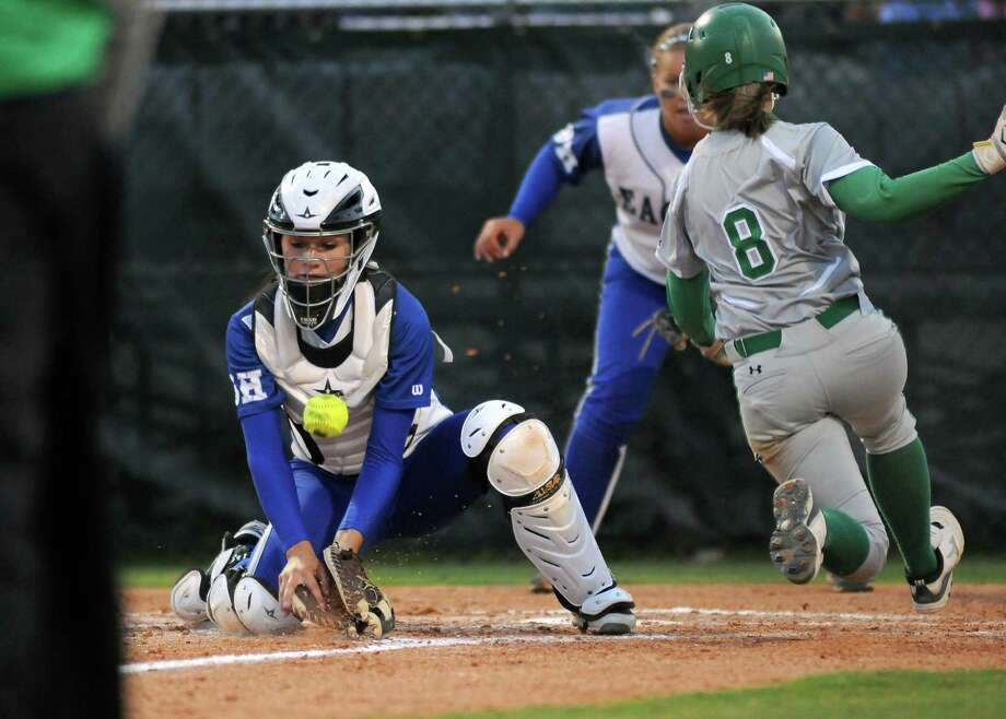 Barbers Hill catcher Sara Rupp, left, tries in vain to tag out Brenham's Olivia Van Hook at home plate in the fifth inning during Game 2 of their area-round playoff series Friday at College Park. Photo: Jerry Baker, Freelance