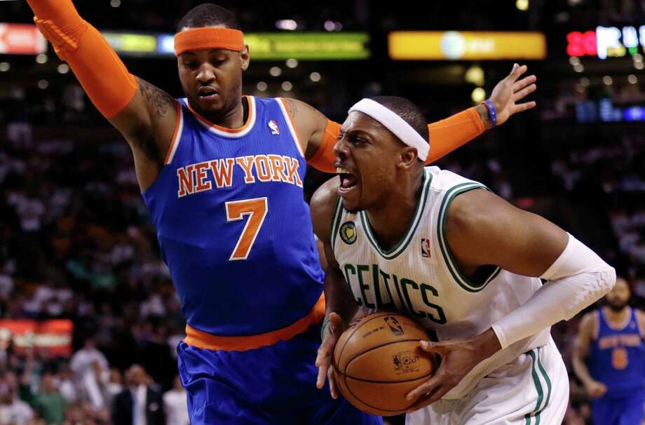 Boston Celtics forward Paul Pierce, right, yells as he tries to drive past New York Knicks forward Carmelo Anthony (7) during the first quarter in Game 6 of their first-round NBA basketball playoff series in Boston, Friday, May 3, 2013. (AP Photo/Charles Krupa) Photo: Charles Krupa