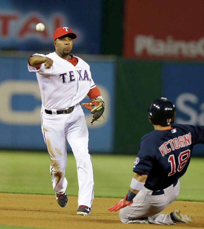 Texas Rangers shortstop Elvis Andrus throws to first after forcing out Boston Red Sox's Shane Victorino (18) during the fourth inning of a baseball game Friday, May 3, 2013, in Arlington, Texas. Red Sox David Ortiz was out at first base. (AP Photo/LM Otero) Photo: LM Otero