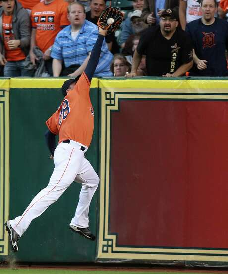 Astros right fielder Rick Ankiel puts in the extra effort to bring down a long fly ball hit by the Tigers' Andy Dirks in the third inning Friday night. Photo: Patric Schneider, FRE / FR170473 AP