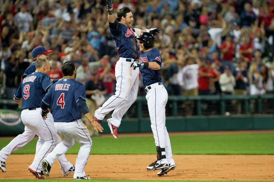 Jason Kipnis, center, was flying high after Drew Stubbs, right, delivered a walk-off RBI double in the 10th inning that sent the Indians past the Twins on Friday. Photo: Jason Miller, Stringer / 2013 Getty Images
