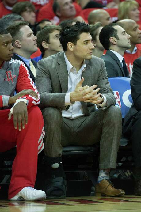 The Rockets' Carlos Delfino aggravated a foot injury in Game 4 that will require surgery next week, relegating him to the bench in Game 6. Photo: Smiley N. Pool, Staff / © 2013  Houston Chronicle