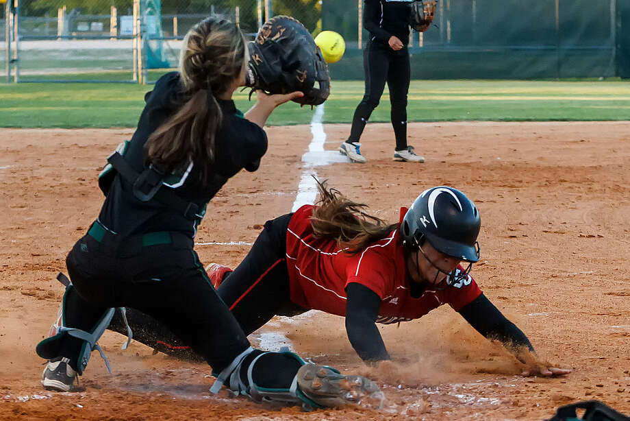 New Braunfels Canyon's Rylee-Kay Mendez beats the throw home during the fourth inning of the Cougarettes' second round playoff victory at Southwest. Photo: Marvin Pfeiffer / San Antonio Express-News
