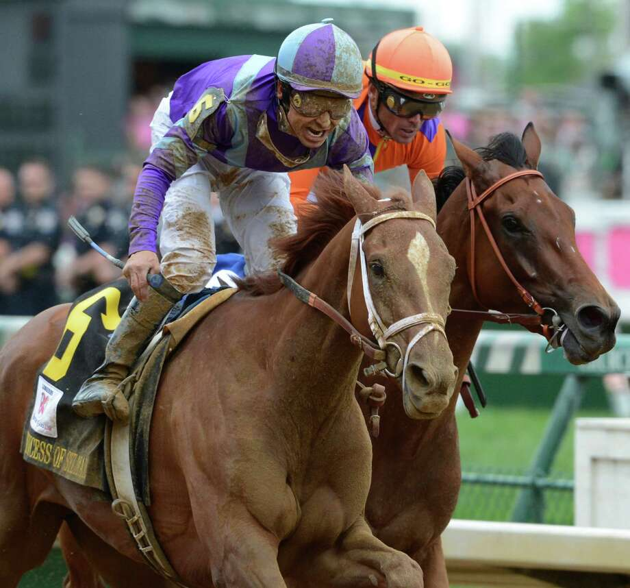 Jockey Mike Smith, foreground, reacts to winning 139th running of the Kentucky Oaks at Churchill Downs May 3, 2013, on Princess of Sylmar in Louisville, Kentucky.  The second place horse was Beholder ridden by Garrett Gomez.    (Skip Dickstein/Times Union) Photo: SKIP DICKSTEIN