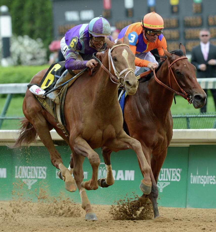 Jockey Mike Smith, foreground, presses hard to win139th running of the Kentucky Oaks at Churchill Downs May 3, 2013, on Princess of Sylmar in Louisville, Kentucky.  The second place horse was Beholder ridden by Garrett Gomez.    (Skip Dickstein/Times Union) Photo: SKIP DICKSTEIN