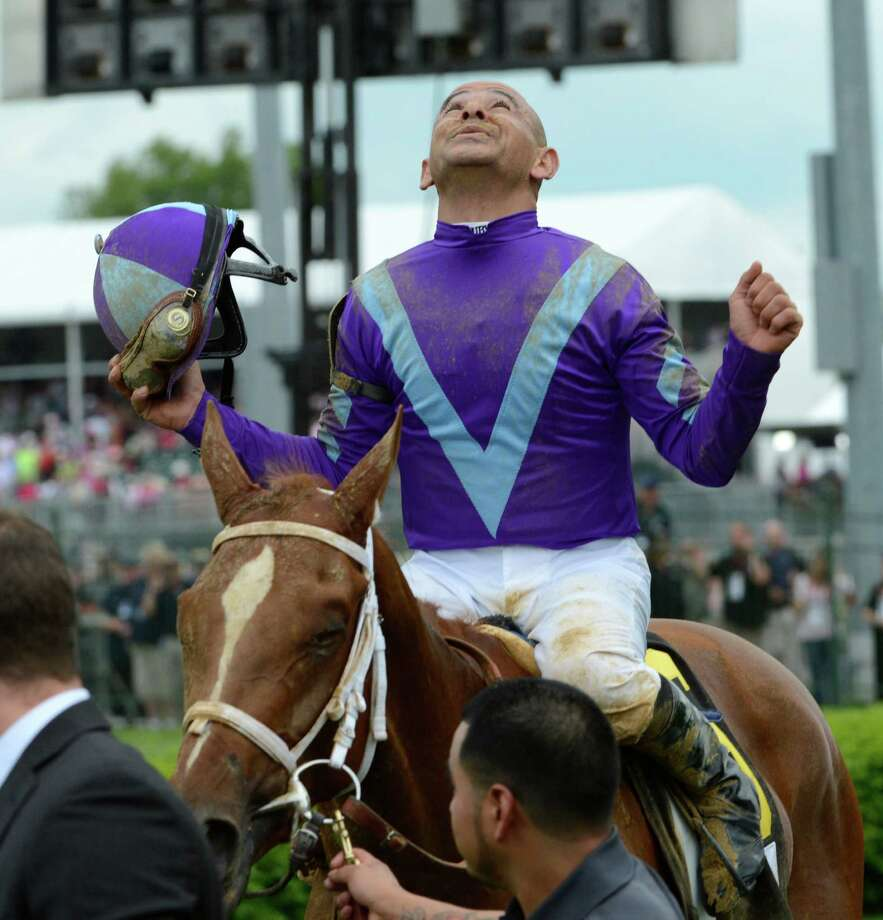 Jockey Mike Smith reacts to winning 139th running of the Kentucky Oaks at Churchill Downs May 3, 2013, on Princess of Sylmar in Louisville, Kentucky.  (Skip Dickstein/Times Union) Photo: SKIP DICKSTEIN