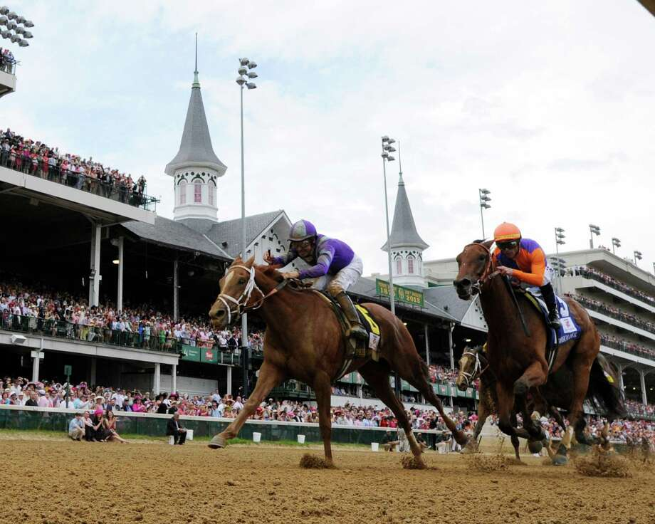 Jockey Mike Smith, foreground, wins the 139th running of the Kentucky Oaks at Churchill Downs May 3, 2013, on Princess of Sylmar in Louisville, Kentucky.  The second place horse was Beholder ridden by Garrett Gomez.    (Skip Dickstein/Times Union) Photo: SKIP DICKSTEIN