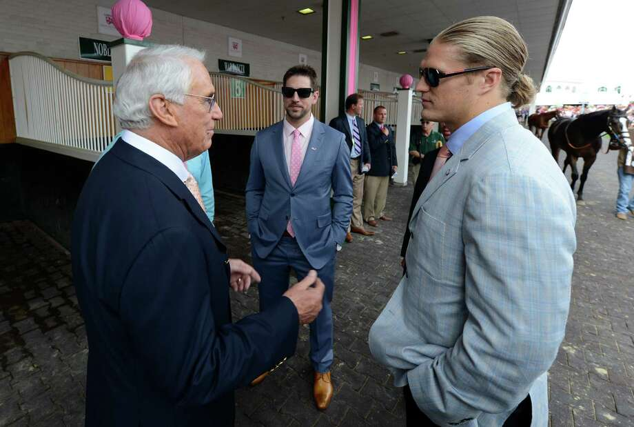 Trainer D. Wayne Lukas, left, speaks with football starts Aaron Rogers, center and Clay Mathews, right before the Kentucky Oaks at Churchill Downs May 3, 2013 in Louisville, Kentucky.  (Skip Dickstein/Times Union) Photo: SKIP DICKSTEIN