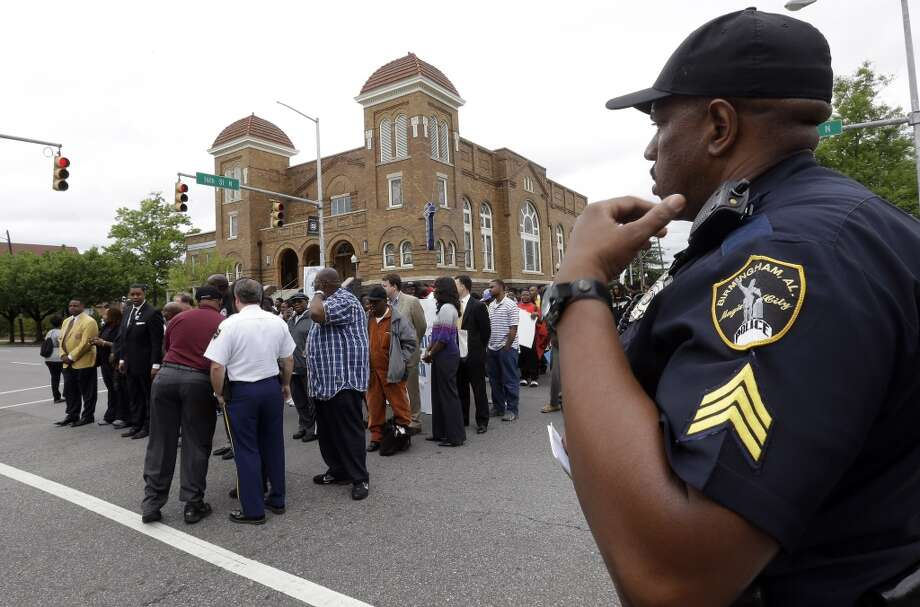 A Birmingham police officer provides security as thousands of children join a march on May 2, 2013.
