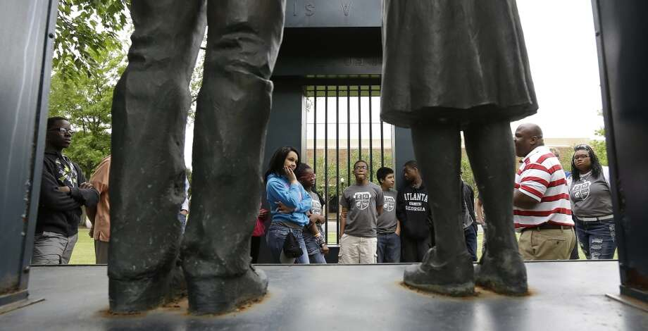 Students from Milwaukee, Wisc., walk past civil rights monuments in Kelly Ingram Park in Birmingham May 2, 2013.