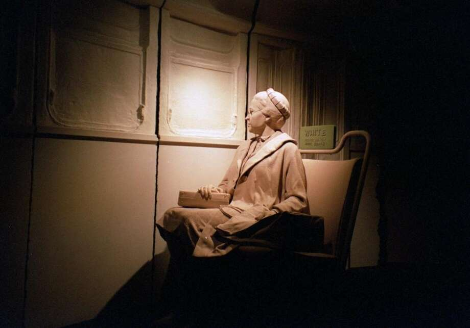 An  exhibit at the Birmingham Civil Rights Institute shows Rosa Parks refusing to give up her seat on a Montgomery bus, a milestone for the movement for equality and social justice. Photo: KRT Photo By Carolyn Barta