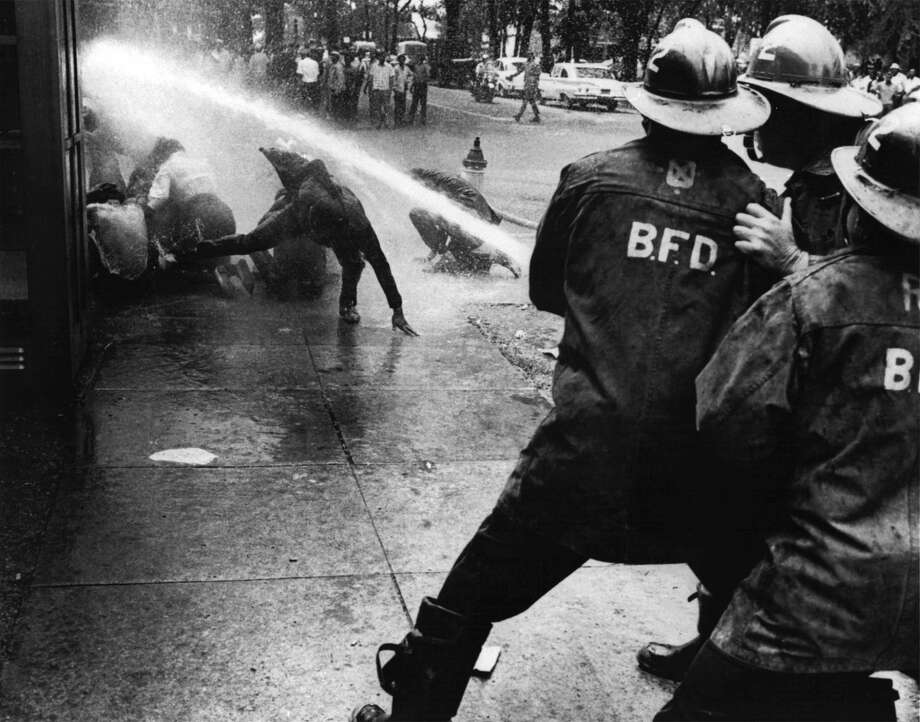 Firefighters turn their hoses full force on civil rights demonstrators on July 15, 1963 in Birmingham. It was one of the focal points of the desegregation movement.