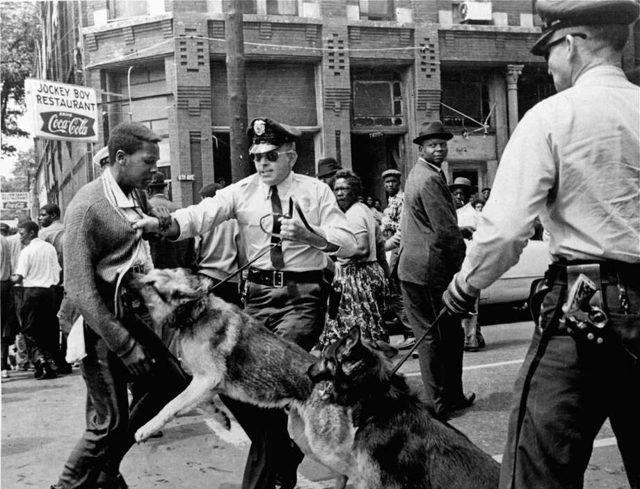 In this May 3, 1963 file photo, a 17-year-old African American civil rights activist is attacked by police dogs during a demonstration in Birmingham.
