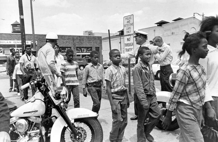 This May 4, 1963 file photo shows policemen leading a group of school children into jail following their arrest for protesting against racial discrimination.