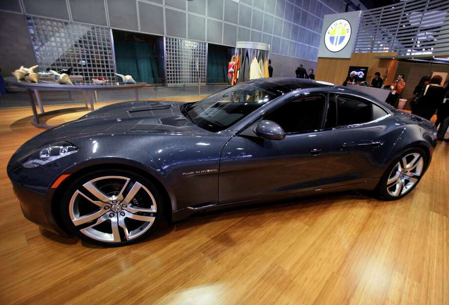 Tesla's rival, the $100,000 Fisker Karma, developed a reputation for glitches. Photo: Damian Dovarganes, STF / AP