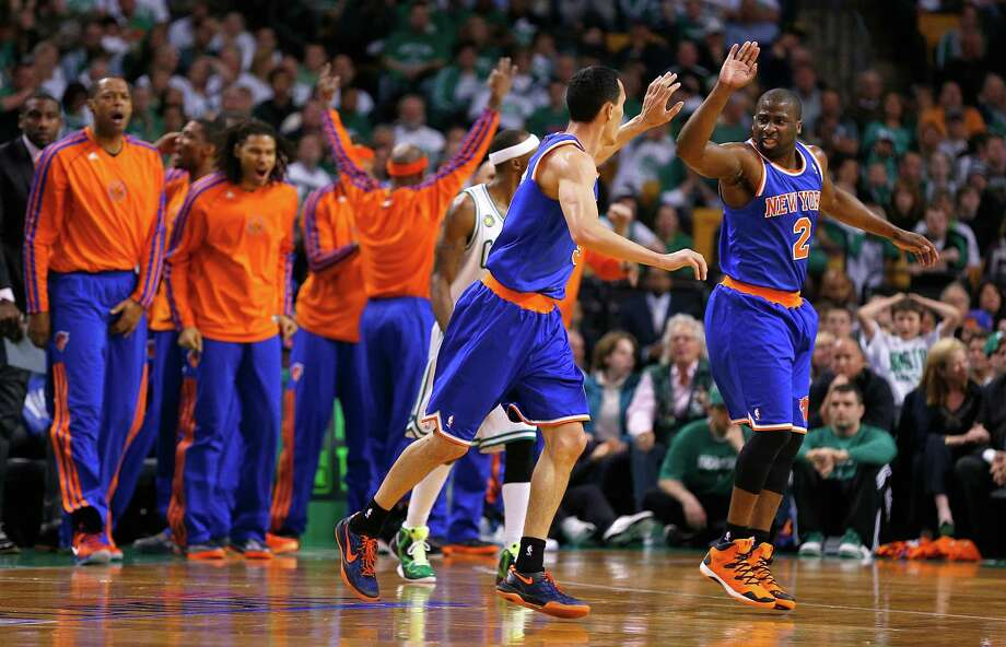 The Knicks' Pablo Prigioni, left, and Raymond Felton (2) celebrate as New York pulls away late in the fourth quarter against Boston on Friday night. Photo: Jim Rogash, Stringer / 2013 Getty Images