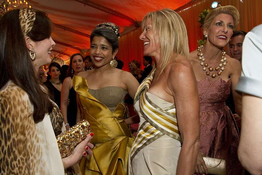 Stephanie Ejabat, Deepa Pakianathan, Rosemary Baker and Karen Caldwell (left to right) chat in the dinner tent during San Francisco Ballet's Cinderella Opening Night Ball at War Memorial Opera House in San Francisco, Calif., on Friday, May 3, 2013.  The party celebrated the opening night and United States premiere of choreographer Christopher Wheeldon's production of Cinderella. Photo: Laura Morton, Special To The Chronicle