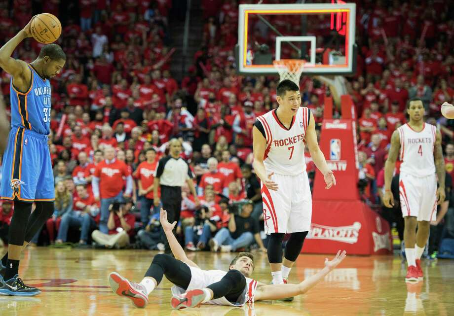The Rockets' Chandler Parsons (on floor) and Jeremy Lin, right, look for a charging call from the officials on the Thunder's Kevin Durant as the first half closes. Photo: Smiley N. Pool, Staff / © 2013  Houston Chronicle